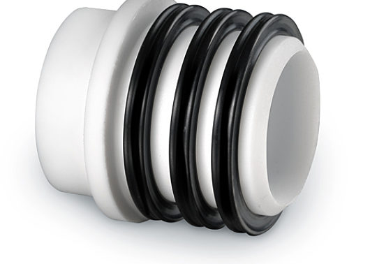 Sleeve-style shaft seal for rotary airlock valves