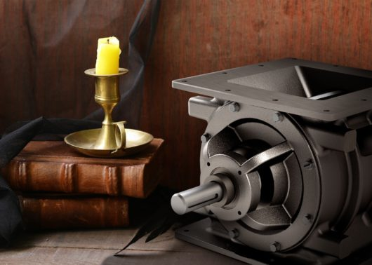 Rotary valve on a spooky backdrop with books and candle