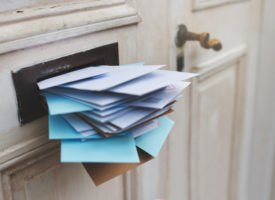 Mail Slot full of Letters
