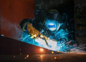 worker using a welding torch on metal